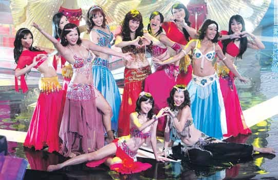 MediaCorp female artist performing belly dancing at Thye Hua Kwan Charity Show 2012.